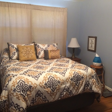 Master bedroom with fresh paint and refinished night stands (ice chests) and hope chest