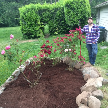 Derek and I cleaned out the rose garden and created a rock barrier, then my family added to it!